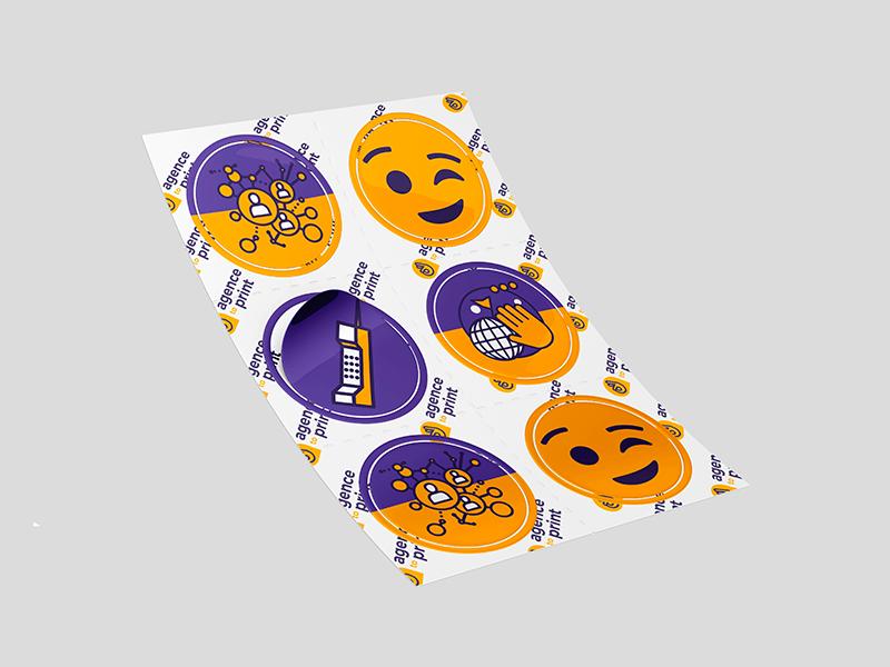 Image d'une planche d'adhésifs rond violet et jaune à poser a soi-même.